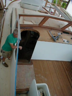 Norm holding down the side panel while the deck rests